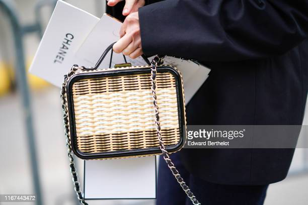 A guest wears a rattan Chanel bag outside the Chanel Cruise Collection 2020 At Grand Palais on May 03 2019 in Paris France