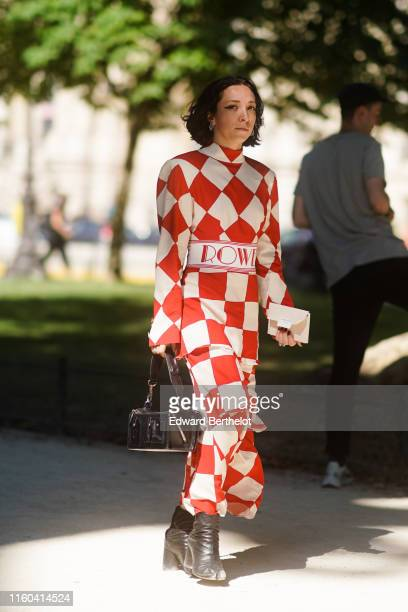 A guest wears a red and white checked dress a black bag black leather shoes outside Alexandre Vauthier during Paris Fashion Week Haute Couture...