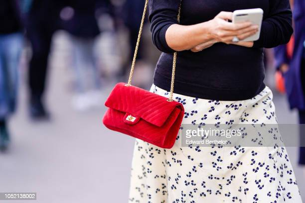 A guest wears a red Chanel bag outside Haider Ackermann during Paris Fashion Week Womenswear Spring/Summer 2019 on September 29 2018 in Paris France