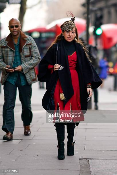 A guest wears a red dress during London Fashion Week Men's January 2018 at on January 6 2018 in London England