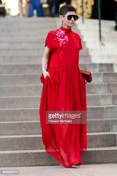 A guest wears a red dress outside the Giambattista Valli show during Paris Fashion Week Haute Couture Fall/Winter 20172018 on July 3 2017 in Paris...