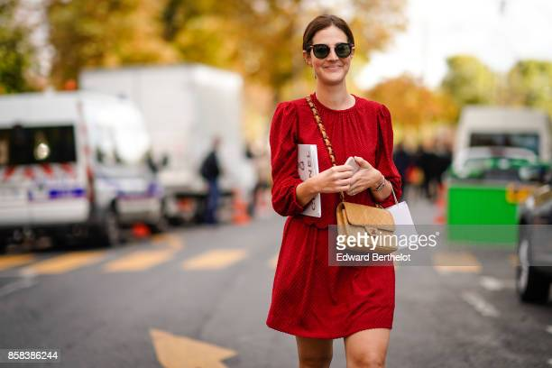 A guest wears a red dress sunglasses a brown chanel bag outside Moncler during Paris Fashion Week Womenswear Spring/Summer 2018 on October 3 2017 in...