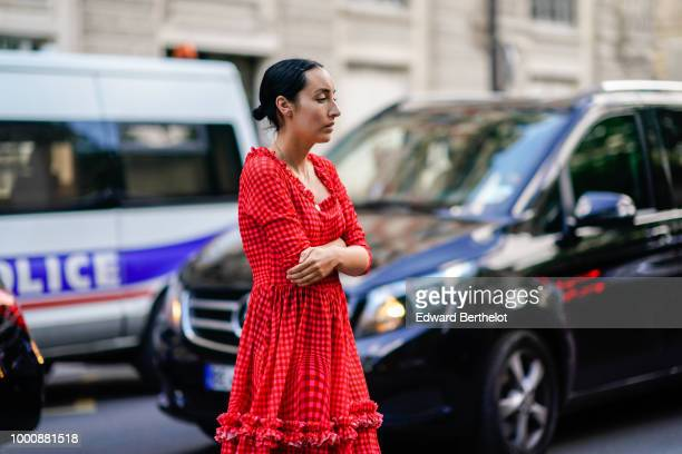 A guest wears a red dress with ruffles during Paris Fashion Week Menswear SpringSummer 2019 on June 22 2018 in Paris France