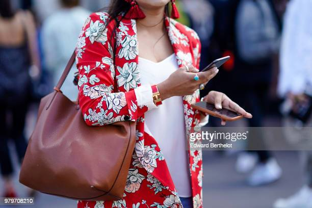 A guest wears a red floral print blazer jacket outside OffWhite during Paris Fashion Week Menswear SpringSummer 2019 on June 20 2018 in Paris France
