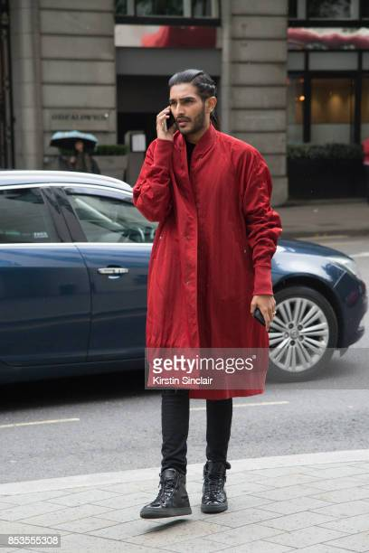A guest wears a red jacket on day 1 of London Womens Fashion Week Spring/Summer 2018 on September 15 2017 in London England