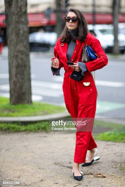 A guest wears a red outfit outside the Moncler Gamme Rouge show during Paris Fashion Week Womenswear Fall/Winter 2017/2018 on March 7 2017 in Paris...