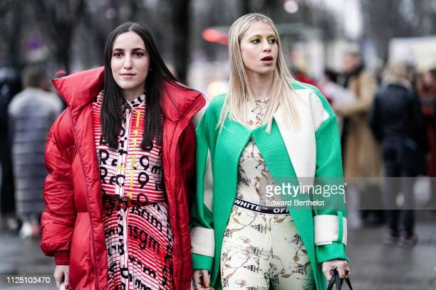 A guest wears a red puffer jacket a guest wears a green coat an OffWhite belt floral print outfit outside Alexandre Vauthier during Paris Fashion...