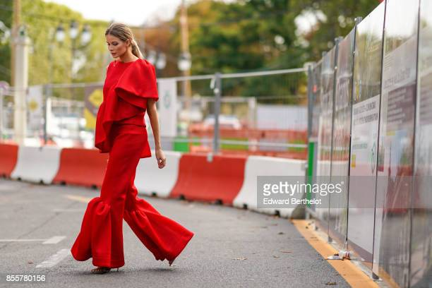 A guest wears a red ruffle top ruffle pants outside Issey Miyake during Paris Fashion Week Womenswear Spring/Summer 2018 on September 29 2017 in...
