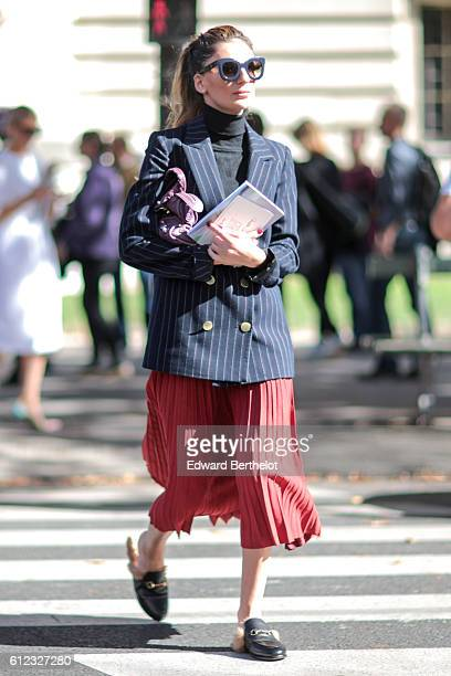 A guest wears a red skirt outside of the Giambattista Valli show during Paris Fashion Week Spring Summer 2017 at Grand Palais on October 3 2016 in...