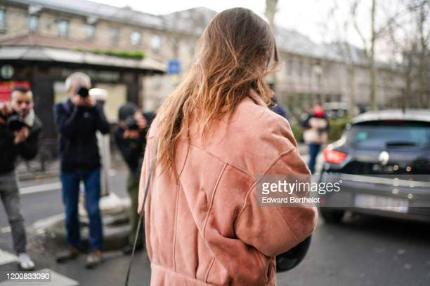 Guest wears a salmon-pink color suede jacket, outside Paul Smith, during Paris Fashion Week - Menswear Fall/Winter 2020-2021 on January 19, 2020 in...
