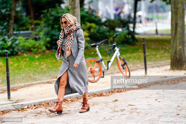 A guest wears a scarf with colored circles a gray coat brown leather boots outside Beautiful People during Paris Fashion Week Womenswear...