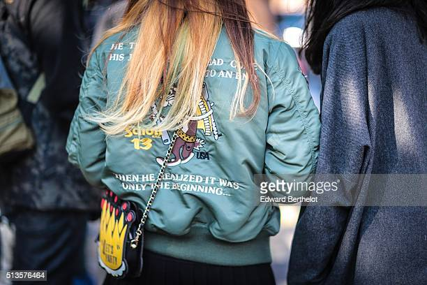 A guest wears a Schott green coat after the Chloe show during Paris Fashion Week Womenswear Fall Winter 2016/2017 on March 3 2016 in Paris France
