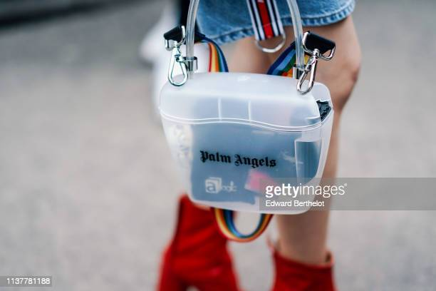 A guest wears a semitransparent bag with a rainbow color strap during London Fashion Week February 2019 on February 16 2019 in London England