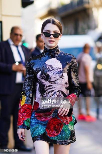 A guest wears a shiny glitter lustrous turtleneck dress with printed flowers outside Valentino during Paris Fashion Week Haute Couture Fall/Winter...