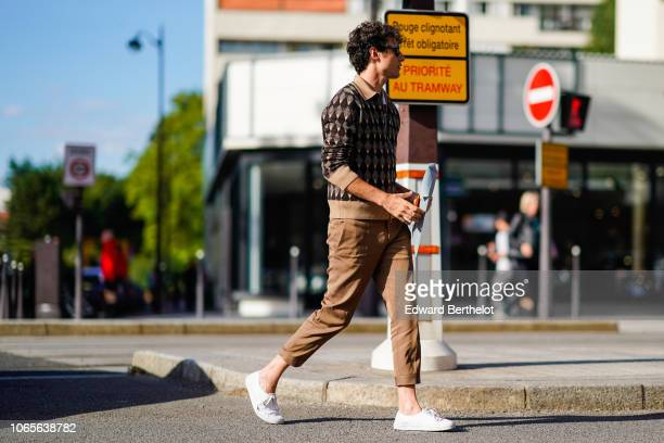 A guest wears a shirt with printed patterns cropped brown pants white shoes outside Dries Van Noten during Paris Fashion Week Menswear SpringSummer...