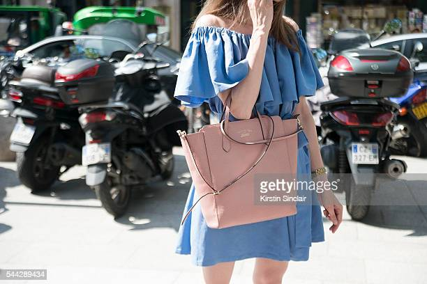 Guest wears a shoulderless dress and Gucci bag on day 2 of Paris Collections Men on June 23 2016 in Paris France Guest