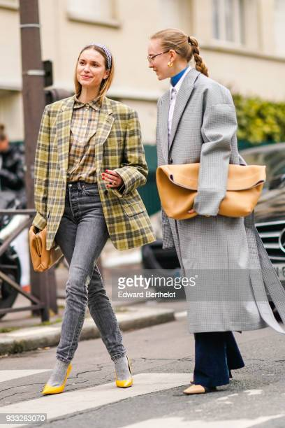 A guest wears a silver headband a yellow plaid jacket a taupe checkered shirt grey jeans grey socks yellow pumps a camel clutch a guest wears a grey...