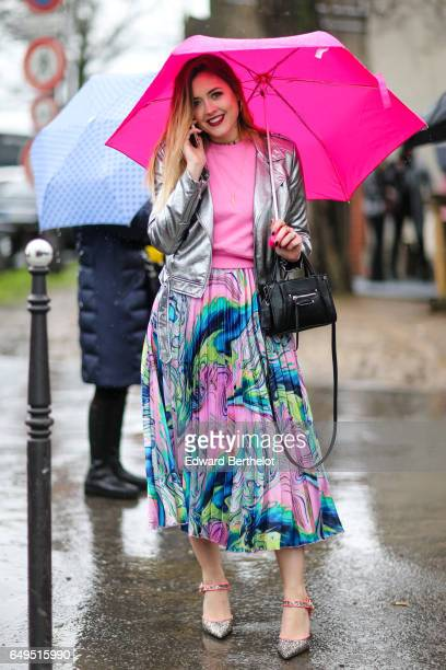 A guest wears a silver jacket a pink top a multicolor pleated skirt outside the Celine show during Paris Fashion Week Womenswear Fall/Winter...