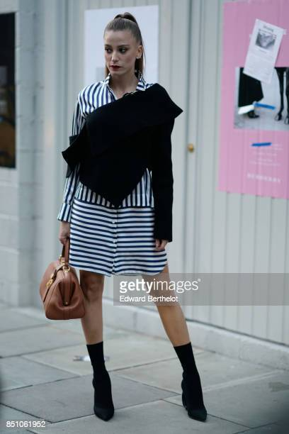 A guest wears a striped dress outside Burberry during London Fashion Week September 2017 on September 16 2017 in London England