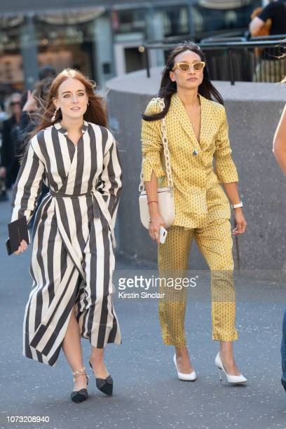 A guest wears a striped dress with Global Buying Director at Net a Porter Elizabeth Von Der Goltz wears Asceno suit Gu_de bag Lucy Folk sunglasses...
