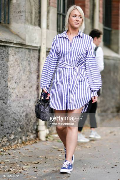 A guest wears a striped dress with sleeves blue sneakers shoes outside the Paul Smith show during Paris Fashion Week Menswear Spring/Summer 2018 on...
