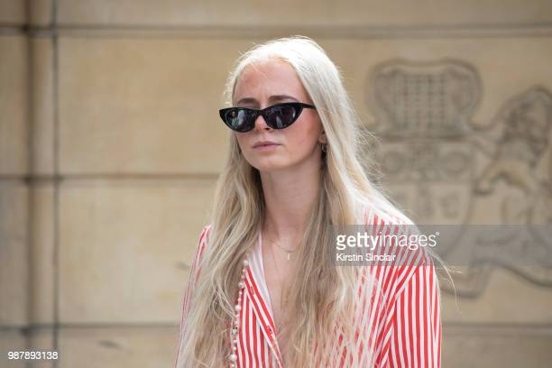 A guest wears a striped shirt during London Fashion Week Men's on June 10 2018 in London England