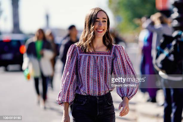A guest wears a striped top outside Margiela during Paris Fashion Week Womenswear Spring/Summer 2019 on September 26 2018 in Paris France