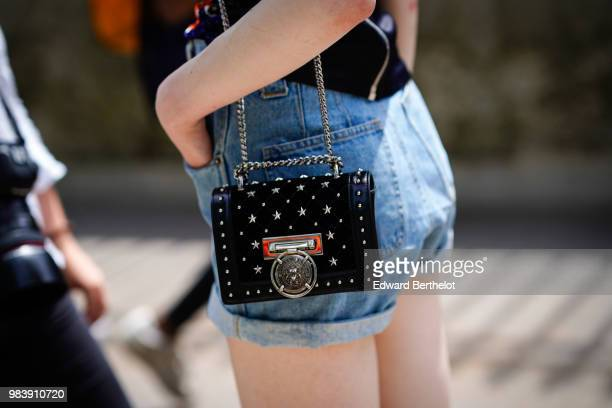 A guest wears a studded bag outside Balmain during Paris Fashion Week Menswear SpringSummer 2019 on June 24 2018 in Paris France