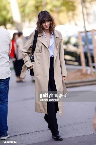 A guest wears a trench coat outside Haider Ackermann during Paris Fashion Week Womenswear Spring/Summer 2019 on September 29 2018 in Paris France