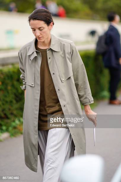 A guest wears a trench coat outside Hermes during Paris Fashion Week Womenswear Spring/Summer 2018 on October 2 2017 in Paris France