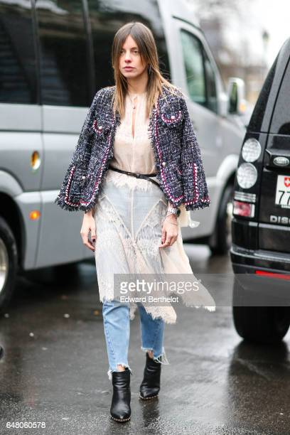 A guest wears a tweed jacket a pink dress a small belt blue denim ripped jeans pants and black shoes outside the Elie Saab show during Paris Fashion...