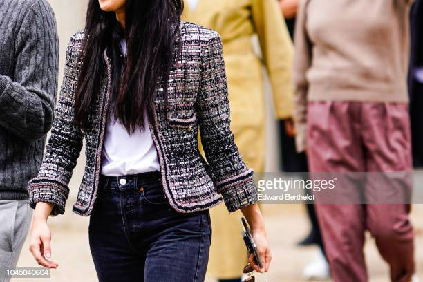 A guest wears a tweed jacket outside Miu Miu during Paris Fashion Week Womenswear Spring/Summer 2019 on October 2 2018 in Paris France