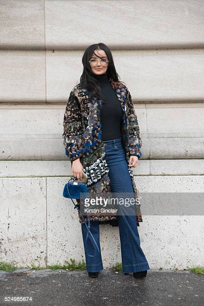 Guest wears a Valentino Coat and Fendi bag on day 7 during Paris Fashion Week Autumn/Winter 2016/17 on March 7 2016 in Paris France A guest