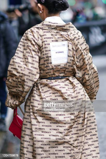 Guest wears a Vetements coat, during New York Fashion Week Women's Fall-Winter 2020, on February 07, 2020 in New York City.