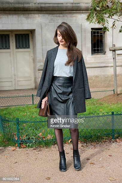 A guest wears a vintage leather skirt and bag and a Zara jacket on day 8 during Paris Fashion Week Spring/Summer 2016/17 on October 6 2015 in Paris...