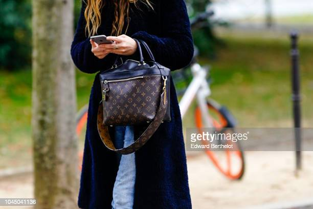 A guest wears a Vuitton bag outside Beautiful People during Paris Fashion Week Womenswear Spring/Summer 2019 on October 2 2018 in Paris France