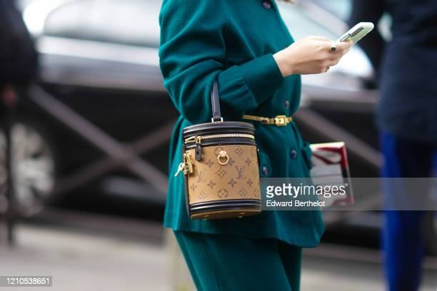A guest wears a Vuitton cylinder shaped monogram bag outside Miu Miu during Paris Fashion Week Womenswear Fall/Winter 2020/2021 on March 03 2020 in...
