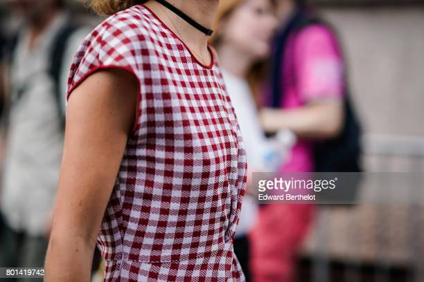 A guest wears a white and red gingham vichy dress outside the Kenzo show during Paris Fashion Week Menswear Spring/Summer 2018 on June 25 2017 in...