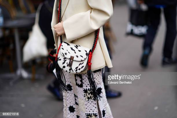A guest wears a white bag with zebra print during Paris Fashion Week Womenswear Fall/Winter 2018/2019 on March 3 2018 in Paris France