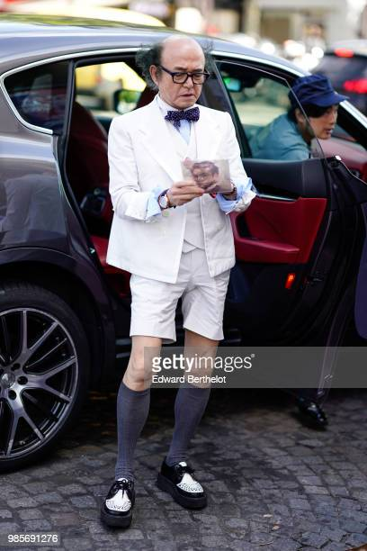 A guest wears a white blazer jacket white shorts long socks shoes a bow tie outside OffWhite during Paris Fashion Week Menswear SpringSummer 2019 on...