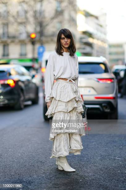 A guest wears a white cropped top a white ruffled skirt white boots outside Rochas during Paris Fashion Week Menswear Fall / Winter 20202021 on...