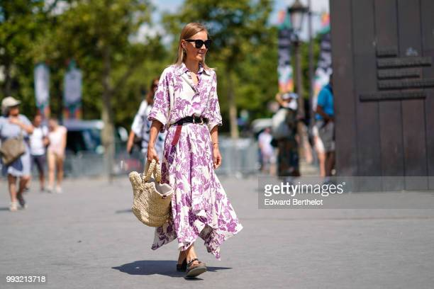 A guest wears a white dress with purple floral prints a basket bag sunglasses outside Chanel during Paris Fashion Week Haute Couture Fall Winter...