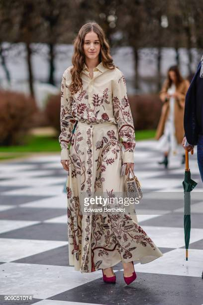16e0067b82e A guest wears a white flower print dress after Dior during Haute Couture  Spring Summer