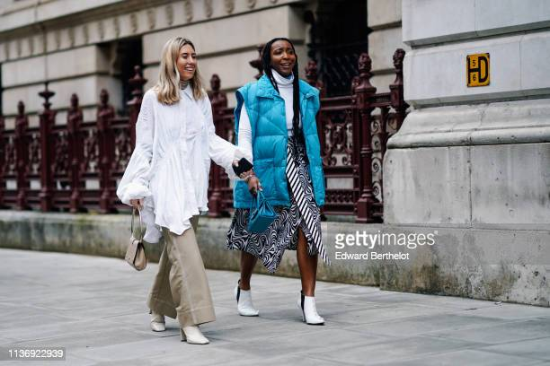 A guest wears a white gathered and ruffled flowing tunic a light brown handbag light khaki white stitched wide leg pants beige boots A guest wears a...