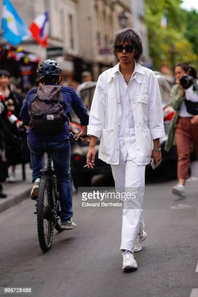 A guest wears a white jacket white shirt white pants white sneakers shoes outside Yohji Yamamoto during Paris Fashion Week Menswear SpringSummer 2019...