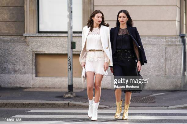 Guest wears a white lace mini dress, a white jacket, a white clutch, a bejeweled belt, white snake skin pattern pointy heeled boots ; A guest wears...