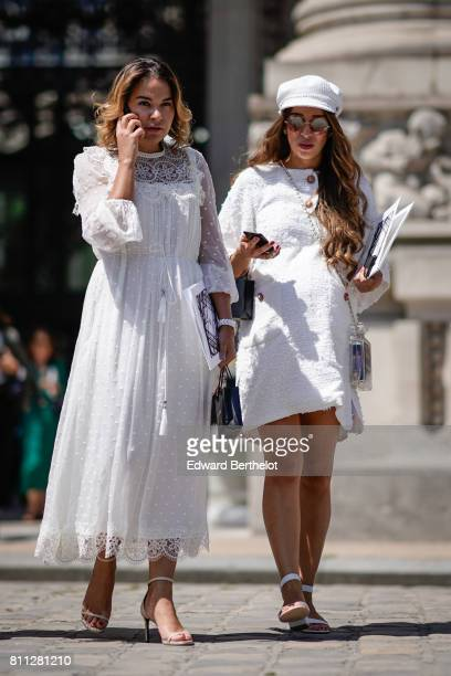 A guest wears a white lace ruffle dress nude heels shoes with traps a guest wears a white hat sunglasses a white tweed dress outside the Chanel show...