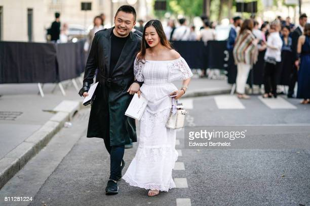 A guest wears a white offshoulder lace dress outside the Valentino show during Paris Fashion Week Menswear Spring/Summer 2018 on June 21 2017 in...