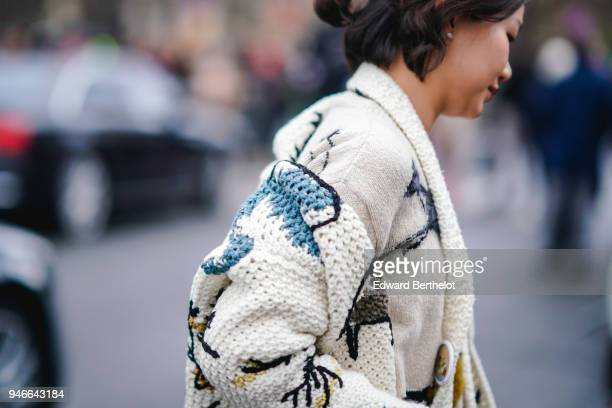 A guest wears a white outfit with colored prints outside Dior during Paris Fashion Week Menswear Fall Winter 20182019 on January 20 2018 in Paris...