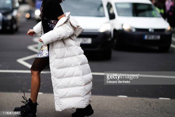A guest wears a white puffer coat during London Fashion Week February 2019 on February 19 2019 in London England